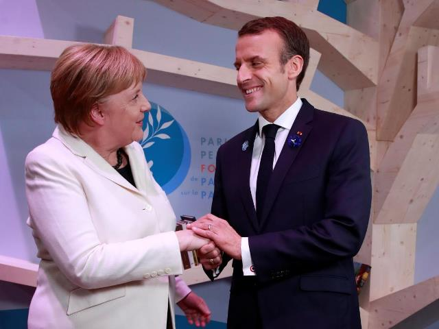 French President Emmanuel Macron joined by German Chancellor Angela Merkel opened the Paris Peace Forum and called for international solidarity. (11/11/2018)
