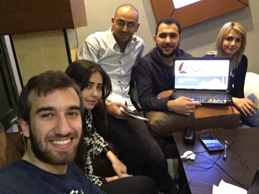 Syrian medical students receiving a tutorial on SyriaScholar.com from doctors in the United Kingdom.(Source: http://syriascholar.com/about-us/history/)